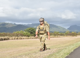 Staff Sgt. Robert Gallagher, 25th Air Support Operations Squadron tactical air control party Airman, participates in a three-mile ruck in full gear during an exercise to learn about field network capabilities at Joint Base Pearl Harbor-Hickam, Hawaii, August 5, 2020. The ruck simulated a deployed experience while providing a workout. (U.S. Air Force photo by 2nd Lt. Benjamin Aronson)