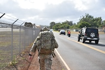 Airmen from the 25th Air Support Operations Squadron perform a three-mile ruck in full gear while stopping at different stations to learn about EvolutionONE, a GPS communication system at Joint Base Pearl Harbor-Hickam, Hawaii, August 5, 2020. This training served as a mid-year assessment of the unit's innovation tactics. (U.S. Air Force photo by 2nd Lt. Benjamin Aronson)