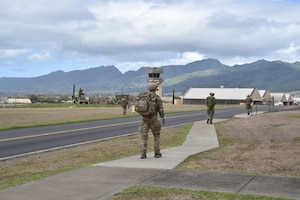 Airmen from the 25th Air Support Operations Squadron perform a three-mile ruck in full gear while stopping at different stations to learn about EvolutionONE, a GPS communication system, at Joint Base Pearl Harbor-Hickam, Hawaii, August 5, 2020. This training served as a mid-year assessment of the unit's innovation tactics. (U.S. Air Force photo by 2nd Lt. Benjamin Aronson)