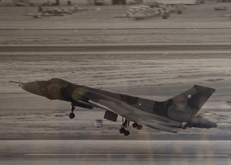 An aircraft lands at Nellis Air Force Base.