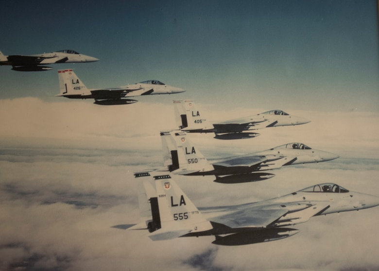 Five F-15s fly in formation.