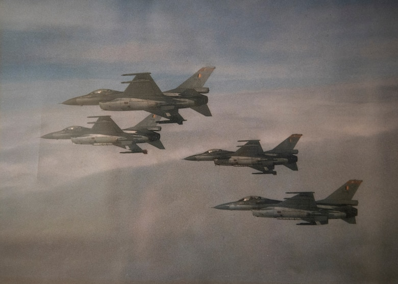 Four Belgian F-16s fly in formation.