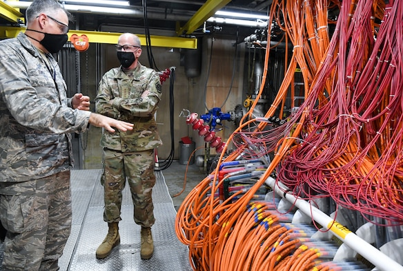 Lt. Col. Adam Quick, left, director of the Arnold Engineering Development Complex (AEDC) Space and Missile Branch, briefs Vice Chief of Staff of the Air Force Gen. Stephen Wilson as they walk through part of the arc heater facility Aug. 11, 2020, at Arnold Air Force Base, Tenn. Arc heaters allow for the testing of thermal protection systems in simulated environments representative of hypersonic flight. (U.S. Air Force photo by Jill Pickett)