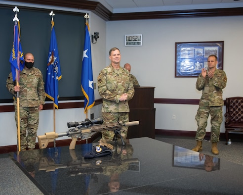 Col. Aaron Guill, center, is welcomed as he takes command of the Air Force Security Forces Center during a change of command ceremony held at Joint Base San Antonio-Lackland, Texas, Aug. 11, 2020. Guill gained command from Col. Brian S. Greenroad, right. (U.S. Air Force photo by Sarayuth Pinthong)