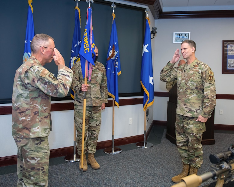 Col. Aaron Guill, right, Air Force Security Forces Center gaining commander, salutes Maj. Gen. Tom Wilcox, Air Force Installation and Mission Support Center commander, during the AFSFC change of command ceremony held at Joint Base San Antonio-Lackland, Texas, Aug. 11, 2020. Guill gained command from Col. Brian S. Greenroad. (U.S. Air Force photo by Sarayuth Pinthong)