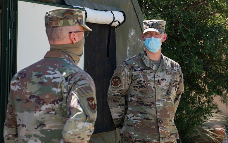 Maj. Gen. Mark Weatherington, 8th Air Force and Joint-Global Strike Operations Center commander, left, speaks with 1st Lt. William Lawson, 7th Operational Medical Readiness Squadron physician assistant, at Dyess Air Force Base, Texas, Aug. 11, 2020.