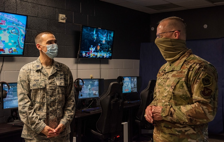 Maj. Gen. Mark Weatherington, 8th Air Force and Joint-Global Strike Operations Center commander, right, questions Capt. Simmon Pena, 7th Force Support Squadron military personnel flight commander, about the eSports program at Dyess Air Force Base, Texas, Aug. 11, 2020.