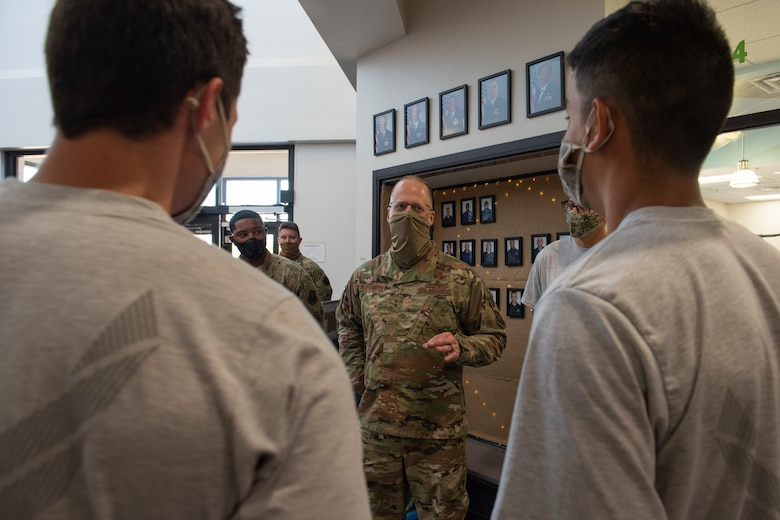 Maj. Gen. Mark Weatherington, 8th Air Force and Joint-Global Strike Operations Center commander, middle, talks with Airmen assigned to the 7th Force Support Squadron about their careers and well-being at Dyess Air Force Base, Texas, Aug. 11, 2020.
