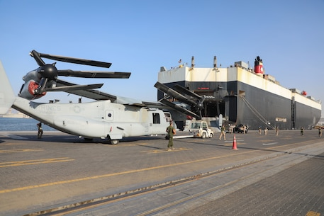 U.S. Marines with Marine Medium Tiltrotor Squadron 166 (Reinforced), assigned to Special Purpose Marine Air-Ground Task Force - Crisis Response - Central Command 20.2, move an MV-22 Osprey off the U.S.-flagged vehicle carrier, the Green Ridge, in Kuwait.