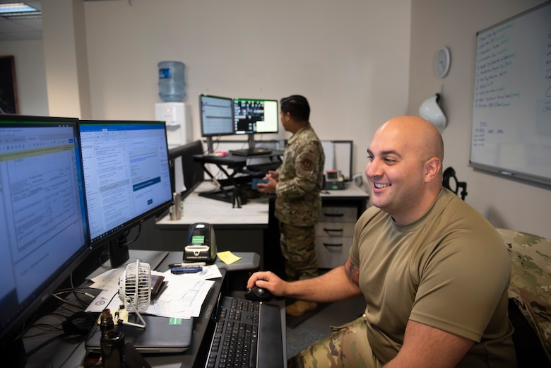 Photo of an Airman working at his desk.