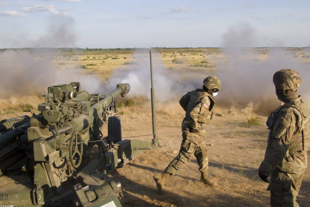 A U.S. Army Soldiers assigned to Bravo Battery, 1st Battalion, 119th Field Artillery Regiment, Michigan Army National Guard, fires a M777 155mm howitzer as part of a direct fire training exercise during Northern Strike 20, Camp Grayling, Michigan, July 25, 2020. The National All Domain Warfighting center in Northern Michigan, of which Camp Graying is a part, is the premier location to replicate the future operating environment, benefiting military readiness. (U.S. Army photo by Sgt. Adam Parent)