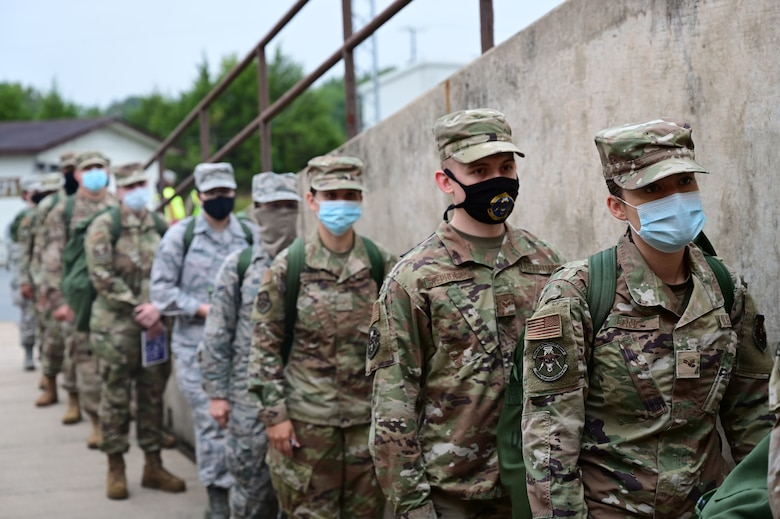 Airmen line up to enter a building before an exercise.