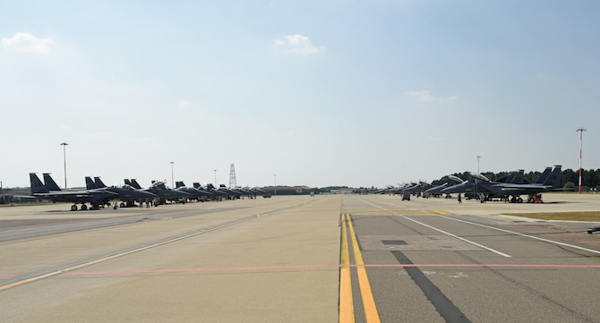A fleet of F-15E Strike Eagles from the 492nd Fighter Squadron and the 494th FS utilizes the newly expanded ramp at Royal Air Force Lakenheath, England, Aug. 12, 2020. The ramp consolidates F-15E Strike Eagle operations for the two squadrons, shortens transit times and maintenance operations, and improves mission efficiency.  (U.S. Air Force photo by Airman 1st Class Rhonda Smith)