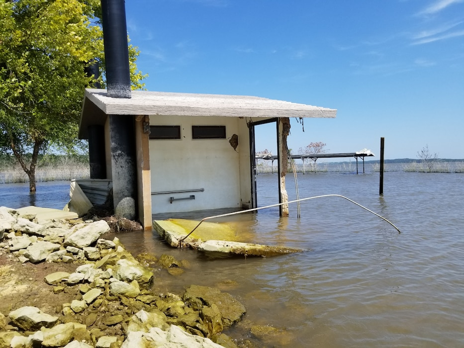 2019 flood waters pounded Tuttle Cove facilities for roughly 7 months – taking their toll on roads, buildings, and campsites.  Repairs will allow park areas to be reopened to the public for the 2021 summer season.