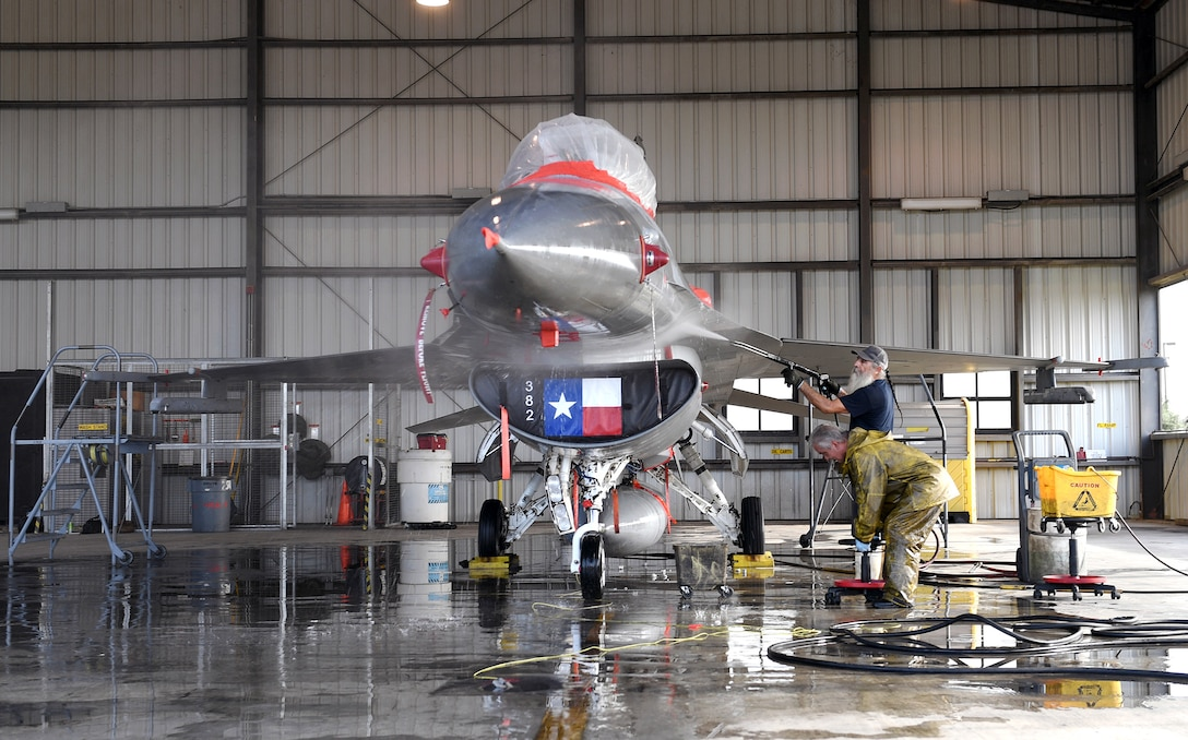 An F-16 Fighting Falcon, assigned to the Air National Guard's 149th Fighter Wing, receives a jet wash at Joint Base San Antonio-Lackland July 24.