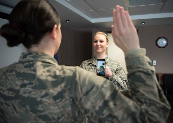Staff Sgt. Elysia Wilson, 168th Wing production recruiter, helps enlist a new recruit using a video conference call April 16, 2020, at Eielson Air Force Base, Alaska. This virtual enlistment allowed a new Alaska Air National Guard recruit to complete their oath of enlistment while complying with COVID-19 safety regulations. (U.S. Air National Guard photo by Senior Airman Shannon Chace)
