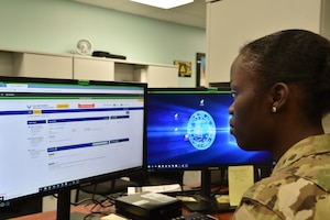 Senior Airman Shakiba Ausbrooks, 15th Comptroller Squadron military pay technician, explains how the Comptroller Service Portal allows Airmen to connect more effectively with the 15th CPTS for financial needs at Joint Base Pearl Harbor-Hickam, Hawaii, July 24, 2020. Airmen will be able to track the progress of their inquiries and even communicate with the technician via CPS. (U.S. Air Force Photo by 2nd Lt. Benjamin Aronson)