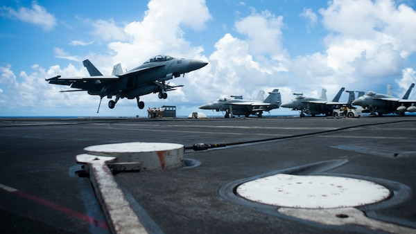 "200814-N- KP021-0245 SOUTH CHINA SEA (August 14, 2020) An F/A-18F assigned to the ""Diamondbacks"" of Strike Fighter Squadron (VFA) 102 lands on the flight deck of America's only forward-deployed aircraft carrier USS Ronald Reagan (CVN 76)  while conducting operations in the South China Sea. Ronald Reagan, the flagship of Carrier Strike Group 5, provides a combat-ready force that protects and defends the United States, as well the collective maritime interests of its allies and partners in the Indo-Pacific region. (U.S. Navy photo by Mass Communication Specialist 2nd Class Codie L. Soule)"