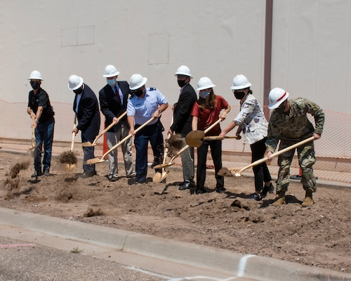 KIRTLAND AIR FORCE BASE, NM- Lt. Col. Patrick M. Stevens, commander, U.S. Army Corps of Engineers-Albuquerque District, (far right) joined Air Force leaders and other team members to break ground on a new Air Force Research Laboratory facility addition August 4, 2020.  