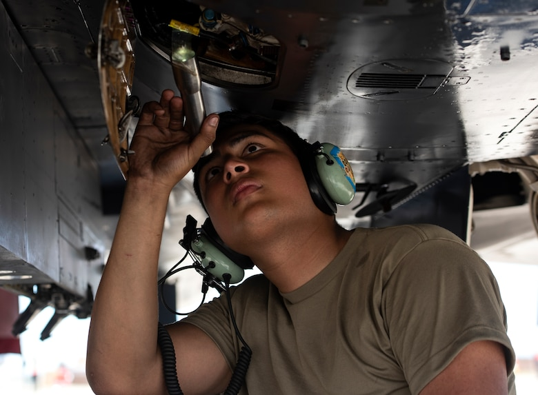 U.S. Air Force Senior Airman Darryon Rivera, 494th Aircraft Maintenance Unit crew chief, checks the fluid levels in an F-15E Strike Eagle at Royal Air Force Lakenheath, England, Aug. 7, 2020. 48th AMXS Airmen ensure Liberty Wing F-15s are fit to fly and can continue to provide superior airpower capabilities when called upon. (U.S. Air Force photo by Airman 1st Class Jessi Monte)