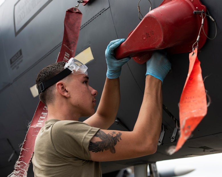 U.S. Air Force Airman 1st Class Wyatt Cresswell, 492nd Aircraft Maintenance Unit crew chief, replaces the covers on an F-15E Strike Eagle at Royal Air Force Lakenheath, England, July 23, 2020. 48th AMXS Airmen ensure Liberty Wing F-15s are fit to fly and can continue to provide superior airpower capabilities when called upon. (U.S. Air Force photo by Airman 1st Class Jessi Monte)