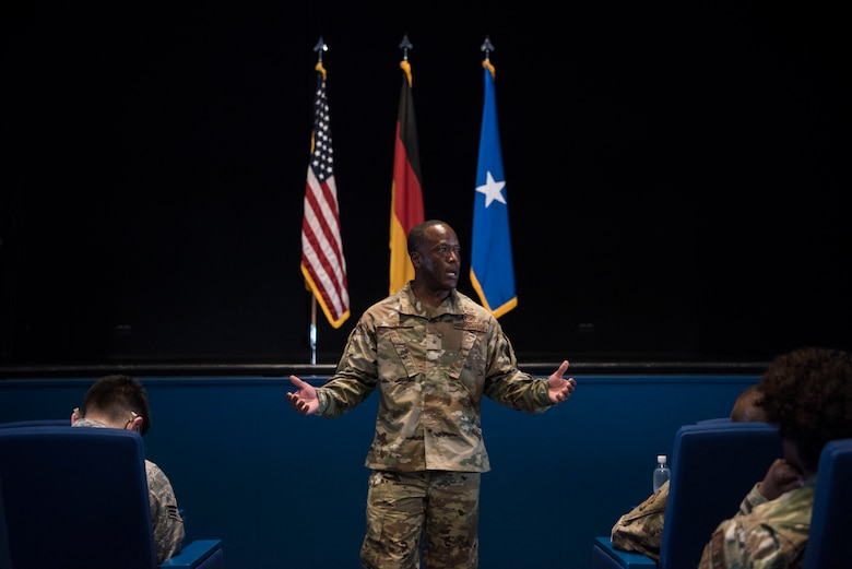 U.S. Air Force Brig. Gen. Ronald E. Jolly, Headquarters U.S. Air Forces in Europe – Air Forces Africa engineering and force protection director of logistics, speaks with Airmen during a forum.