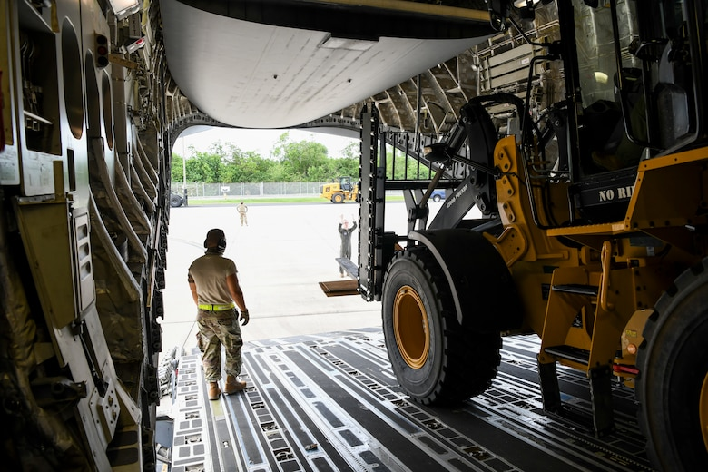 A U.S. Air Force C-17 Globemaster III cargo airplane with the 176th Wing, Alaska Air National Guard, arrives at the 156th Wing, Muñiz Air National Guard Base, Aug. 7, 2020, delivering Disaster Relief Beddown System equipment to the Puerto Rico Air National Guard. The DRBS from the 119th Wing, North Dakota ANG, is one of two systems that the PRANG is receiving to provide needed support to first responders after a natural disaster.