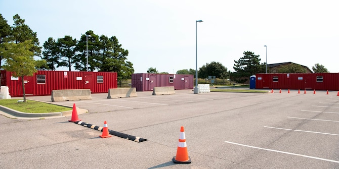Three temporary buildings in parking lot of clinic.