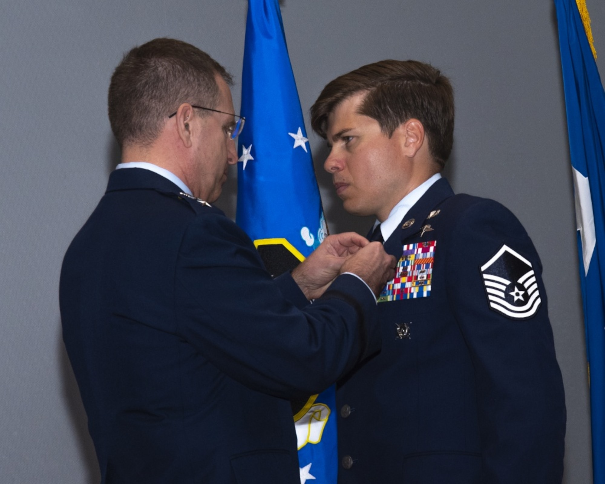 image of Master sergeant john grimesey receiving silver star medal from lieutenant general jim slife