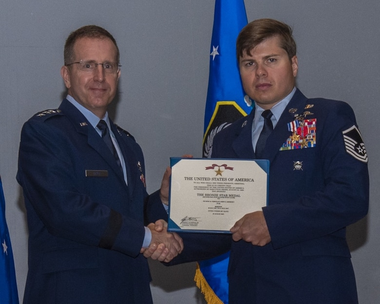 image of Master sergeant john grimesey receiving silver star medal from lieutenant general jim slife