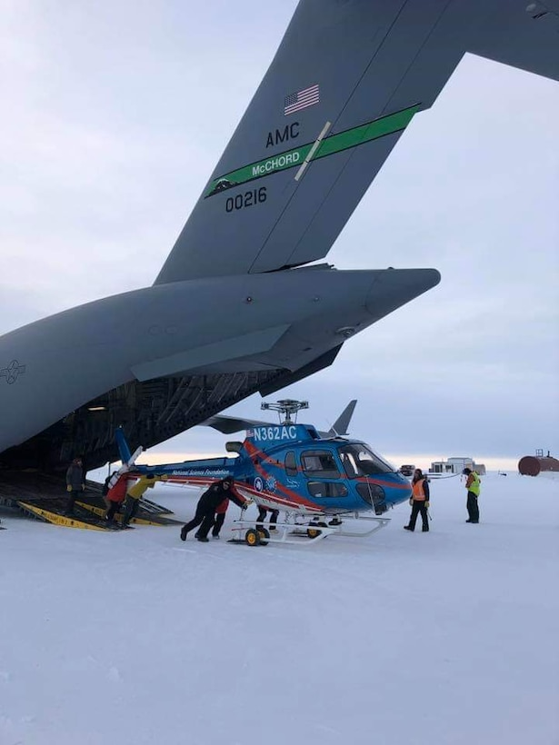 Loadmasters from the 62nd Airlift Wing work with U.S. Antarctic Program cargo handlers to offload a National Science Foundation helicopter on Phoenix Airfield, Antarctica, in this February 2019 file photo. Airmen from Joint Base Lewis-McChord deploy annually as the 304th Air Expeditionary Squadron to Antarctica to deliver people and supplies to the McMurdo scientific research station. (Courtesy photo by Lt. Col. Brandon Tellez)
