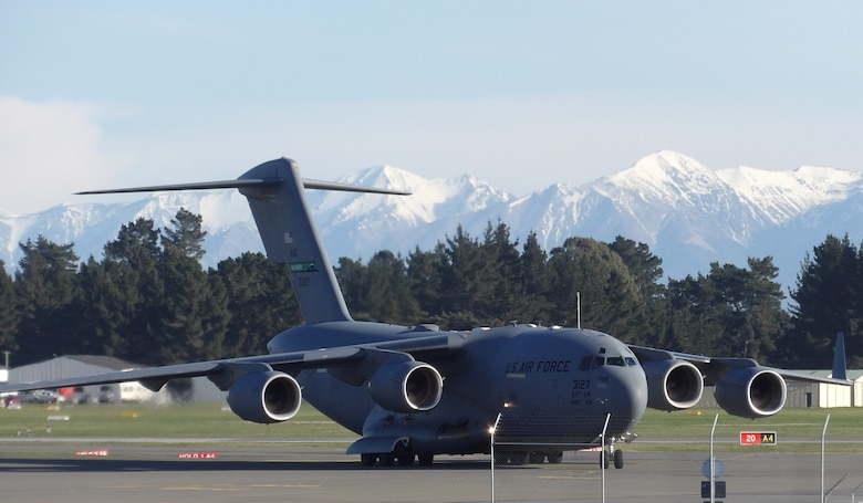A C-17 Globemaster III from Joint Base Lewis-McChord, Wash., lands at the Christchurch Airport in Christchurch, New Zealand, Aug. 7, 2020. Before conducting the Operation Deep Freeze mission, air crew and personnel from Joint Base Lewis-McChord must go through a 14-day quarantine to mitigate the spread of COVID-19 and maintain Antarctica as the only continent that hasn't had a case of the virus. (Courtesy photo by Ron Rogers)