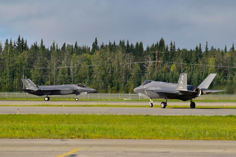 Two F-35A Lightning IIs prepare for take off during RED FLAG-Alaska 20-3 on Eielson Air Force Base, Alaska, Aug. 13, 2020. F-35s from Eielson as well as Hill Air Force Base, Utah, participated in the large force exercise and added a fifth-generation element to the aerial warfare training event. (U.S. Air Force photo by Senior Airman Beaux Hebert)