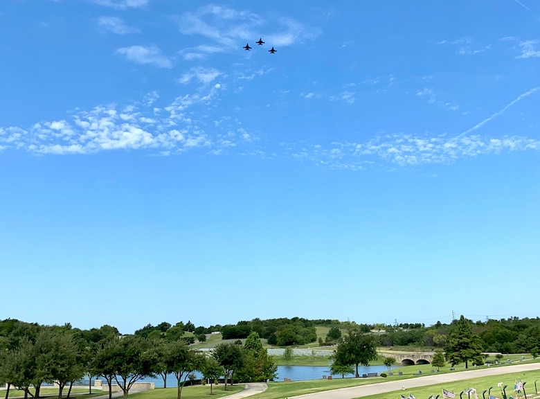 "F-16 pilots assigned to the 457th Fighter Squadron, 301st Fighter Wing, performed a memorial flyover at Dallas Fort Worth National Cemetery to honor POW and F-16 program founder, Brigadier General Lyle Cameron on August 7. They flew a ""missing man"" formation flyover for his remaining family members, friends and those in attendance. (U.S. Air Force photo by Capt. Jessica Gross)"