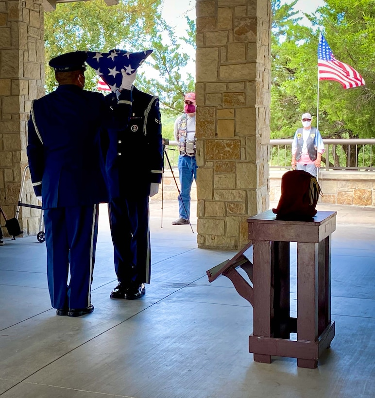 Airmen from the Dyess Air Force Base Honor Guard prepare a memorial flag for POW and F-16 program founder, Brigadier General Lyle Cameron's wife on August 7 during a funeral ceremony at Dallas Fort Worth National Cemetery. Before his contributions to the F-16 program, Brig. Gen. Cameron was held captive for 32 months at a prisoner of war camp in Mukden (Shenyang), China. (U.S. Air Force photo by Capt. Jessica Gross)