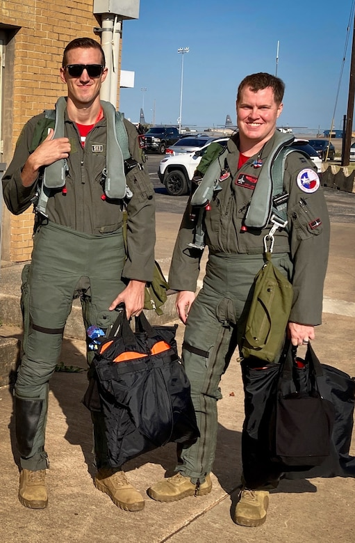 Two pilots from the 457th Fighter Squadron pause prior to performing a memorial flyover for POW and F-16 program founder, Brigadier General Lyle Cameron on August 7 at Dallas Fort Worth National Cemetery. The Spads of the 457 FS have been flying the F-16 Fighting Falcon for more than 25 years. (Courtesy photo)