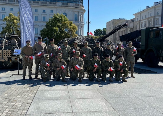 Military members from the United States, Poland, United Kingdom, Romania, and Croatia gather for a group photo during Polish Armed Forces Day at Warsaw, Poland, August 15, 2020. The U.S. military presence in Poland strengthens NATO deterrence and contributes to security in the region. Enhancing that presence would help continue to ensure democracy, freedom and respect for sovereignty. (U.S. Air Force photo by Senior Airman Melody W. Howley)