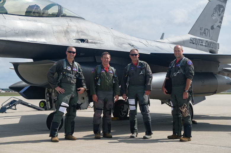 Col. Cory Kestel, 114th Operations Group commander, poses for a photo with Col. Mark Morell, 114th Fighter Wing commander, Lt. Col. Josh Wika, 175th Fighter Squadron commander, and Lt. Col. Steven Schultz, 114th Operations Group chief of standard evaluation, after completing 3000 flight hours at Joe Foss Field, S.D., Aug. 14, 2020.