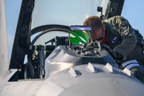 Col. Cory Kestel,114th Operations Group commander, prepares a F-16 fighting falcon for launch prior to his 3000 hour flight at Joe Foss Field, S.D., Aug. 14, 2020.