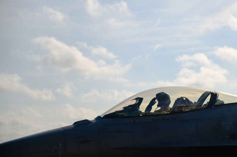 Col. Cory Kestel,114th Operations Group commander, salutes prior to taking off for his 3000 hour flight at Joe Foss Field, S.D., Aug. 14, 2020