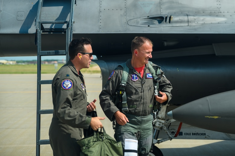 Col. Cory Kestel,114th Operations Group commander, is greeted by Lt. Col. Jeremy Doohen, 114th Operations Support Squadron director of operations, after landing his 3000 hour flight at Joe Foss Field, S.D., Aug. 14, 2020