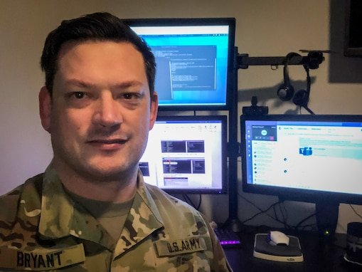 U.S. Army Reserve Lt. Col. Blake Bryant, a cyber officer with Cyber Protection Team 185 poses for a photo during his unit's Virtual Battle Assembly Aug. 9, 2020.