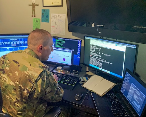 "U.S. Army Reserve Maj. Jared Hrabak, a cyber officer with Cyber Protection Team 185 uses a common network scanning tool ""masscan"" to enumerate a network"