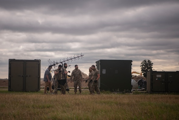 Airmen with the 352d Special Operation Support Squadron Communications flight adjust the position of an antenna during an exercise Aug. 5, 2020, at RAF Mildenhall, England. The exercise tested the flight's employment of tactical communication capabilities among three geographically separated units in a simulated contested environment. Special operations forces bring unique capabilities and expertise in unconventional warfare which contributes to overall campaign planning and execution.