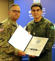 Military personnel hold a certificate.