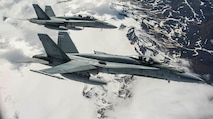 Photo of two Royal Canadian Air Force C-18s in flight.