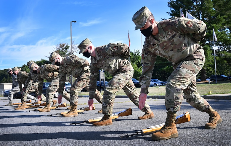 Members of the 66th Force Support Squadron Patriot Honor Guard follow commands during a ceremonial drill training session at Hanscom Air Force Base, Mass., Aug. 13. The guardsmen have modified their drills to comply with physical distancing standards to ensure they can continue supporting veterans' funerals across New England and New York. (U.S. Air Force photo by Linda LaBonte Britt)