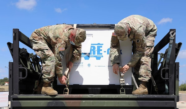 Sgt. 1st Class Jason Mcallister and Sgt. Joshua Glassburner secure equipment for the joint inspection conducted by Joint Base San Antonio-Lackland personnel during the Headquarters and Headquarters Battalion, U.S. Army South validation exercise of the battalion's deployment of the contingency command post personnel from Aug. 10-14
