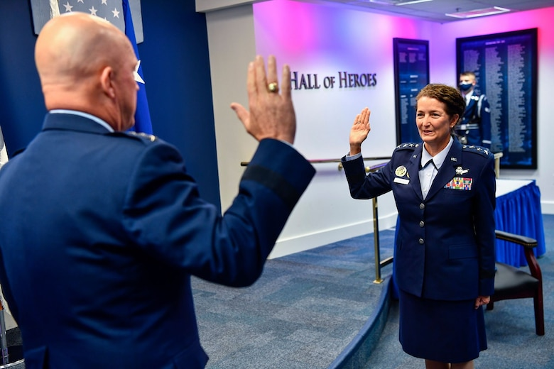 Lt. Gen. Nina M. Armagno recites the oath of office with Chief of Space Operations Gen. John W. Raymond during her promotion ceremony at the Pentagon, Arlington, Va., Aug. 17, 2020. Armagno transferred from the Air Force to Space Force during the ceremony. (U.S Air Force photo by Eric Dietrich)