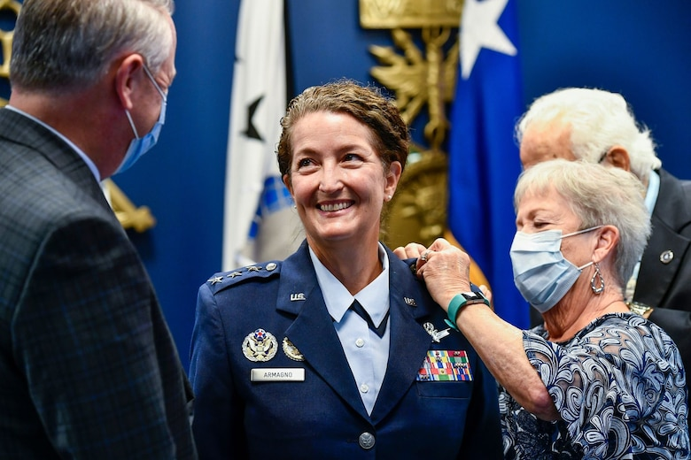 Lt. Gen. Nina M. Armagno has her new rank pinned on by her family during her promotion ceremony at the Pentagon, Arlington, Va., Aug. 17, 2020. Armagno transferred from the Air Force to Space Force during the ceremony. (U.S Air Force photo by Eric Dietrich)